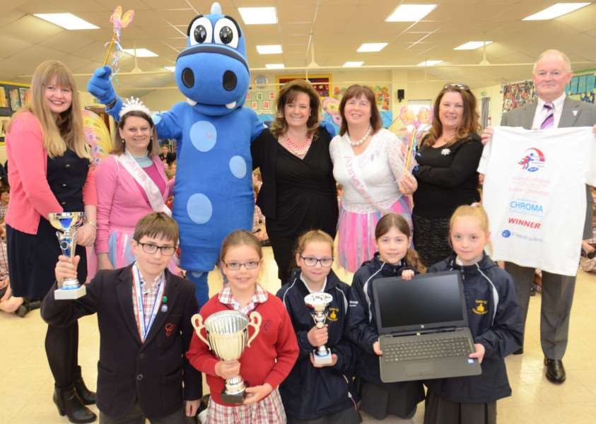 Carole Hughes from Anna's Hope with sponsors and William Grooby and Lily Underwood (Copthill School) and Poppy and Kitty Evans and Holly Fone from Castor C of E school at presentations after the fundraising at the Great Eastern Run last year EMN-160427-175252009