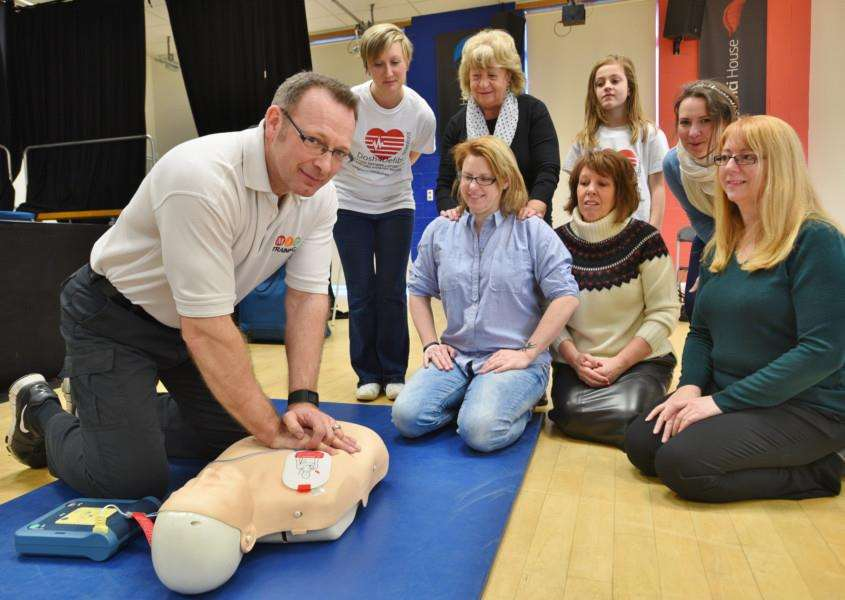 Dannii Vincent from Dosh4defibs with training director Darren Mitchell with first aiders attedning a course at Welland Academy EMN-160219-174715009