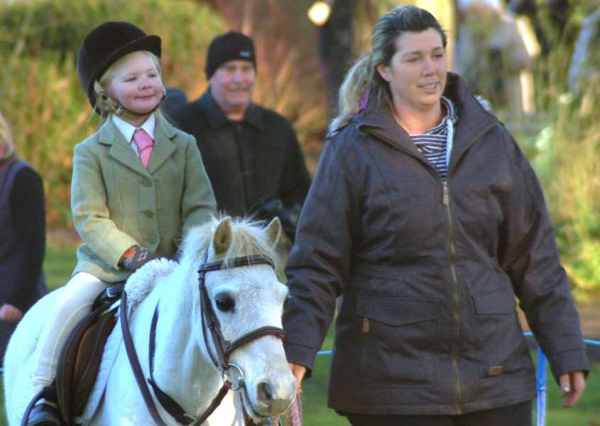 Four-year-old Maisie Brown rides her pony Bobby with mum Melissa at the traditional New Year hunt meet in Melton this week EMN-170301-120158001