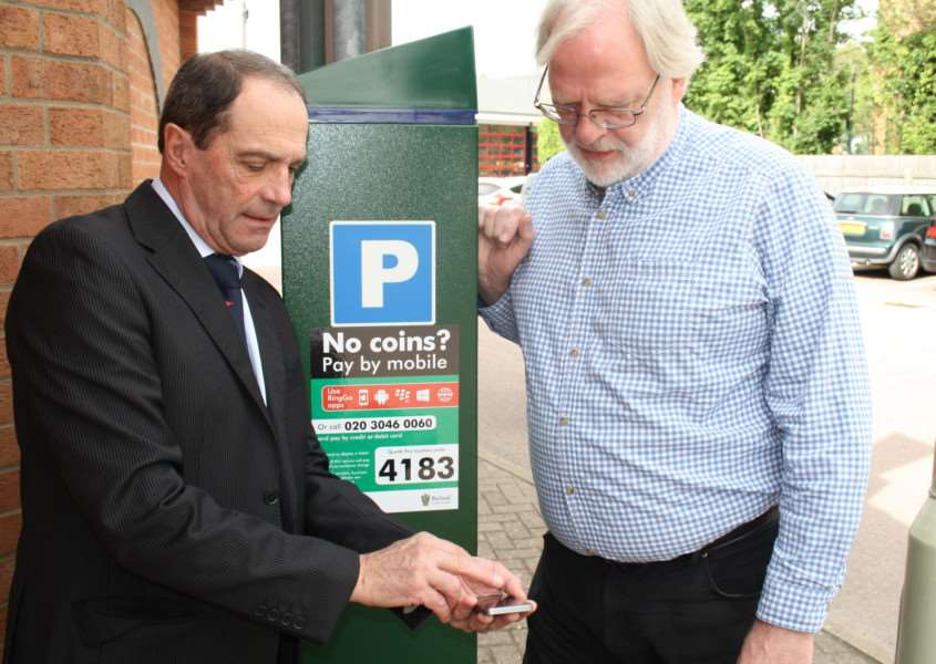 Cashless parking is introduced to Rutland. RingGo Implementation Manager John Wheeley shows Rutland county councillors Tony Mathias (Con) how to use the new system. EMN-151108-164303001