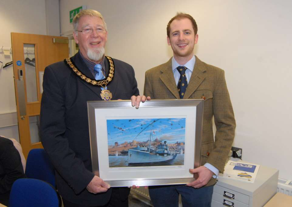 Presentation of print of HMS Beryl - a minesweeper adopted by Bourne during the Second World War - Bourne town mayor Bob Russell receives a framed copy of the print from Andrew Whyte.'Photo: MSMP030315-002js EMN-150403-082813001