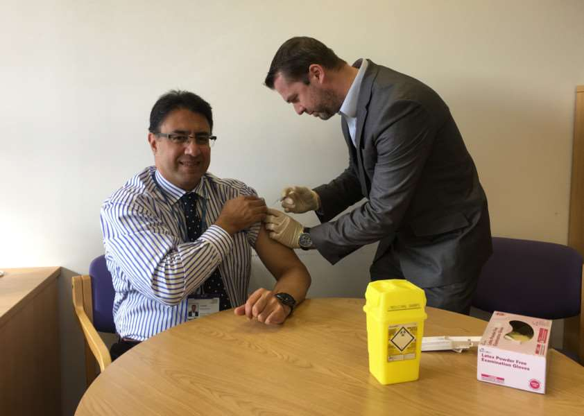 Professor Aly Rashid, medical director of NHS England in Lincolnshire, has his flu vaccination.