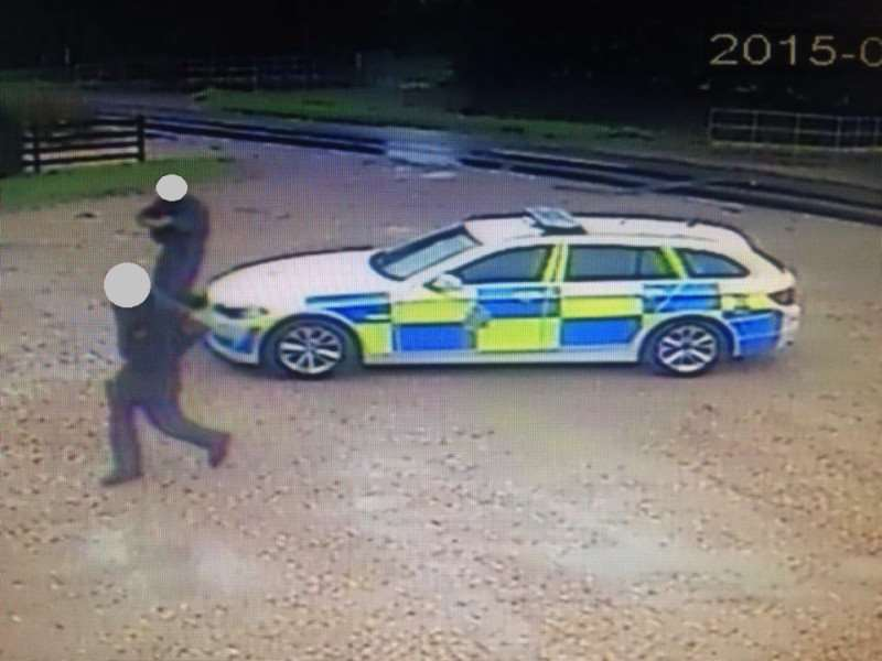 Armed police swoop on a car wash before seizing a toy gun belonging to Eduardo Legavicius (9).
