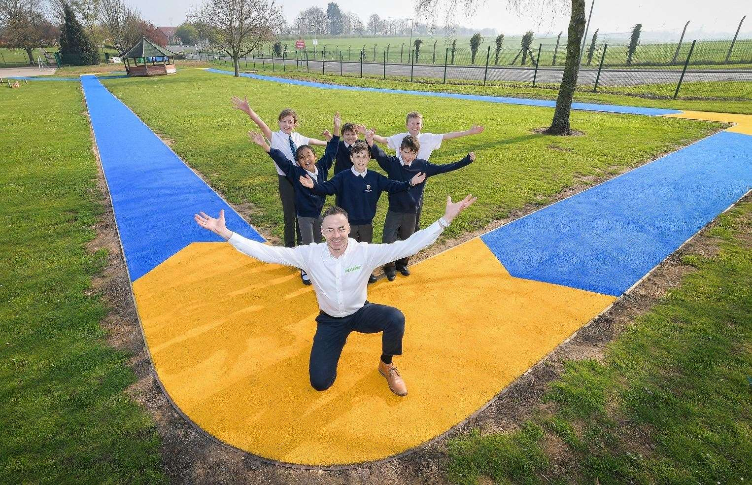 Copyright 2018 Mike Sewell (tel: 07966 417114) Photograph by Mikey Sewell.Lazy Lawn have installed a blue and yellow running track at the Cottesmore Academy in Rutland. The idea is for their pupils to do a daily mile on the track.(Commissioned by Hannah Elwell - Unsworth Sugden) (8506045)