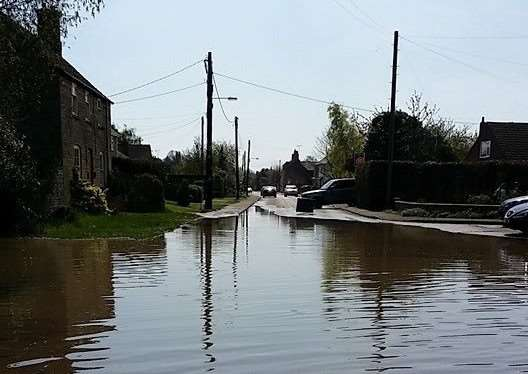 Flooding in King Street, West Deeping, after a water main burst. Photo: Alison Ireland. EMN-150423-112221001