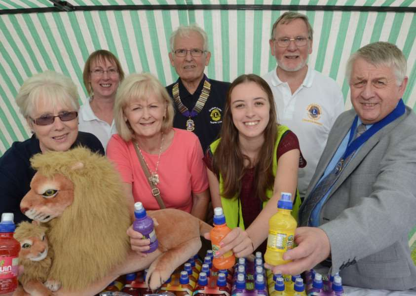 Lions Family Fun Day at Bourne recreation ground. Pictured are Bourne Lions Club stall holders Carol reeves, Chris Chudley, Brenda Crane, President Graham Crane, Laura Golding and Frank Reeves with Bourne deputy Mayor Philip Knowles. EMN-140713-203954009