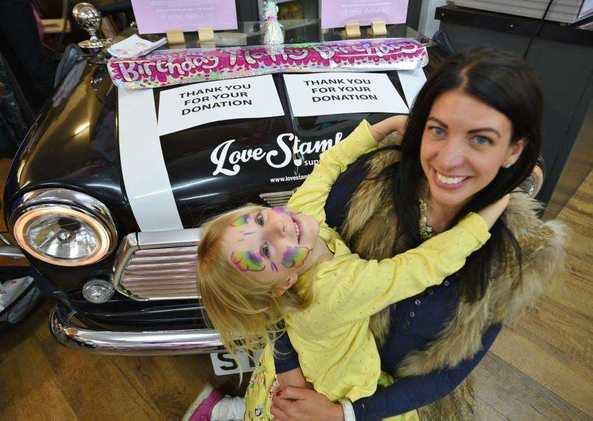 Love Stamford first birthday celebrations at Broad Street. Zoe Crowson and daughter Phoebe (5) who were being sponsored from the days fundraising EMN-150530-173106009