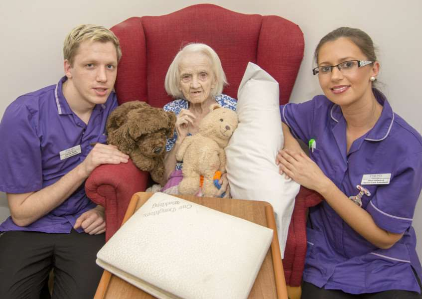 Evelyn Palmer with Abbey Court Care Home staff, Gareth Slark and Jana Hellerova. By Lee Hellwing