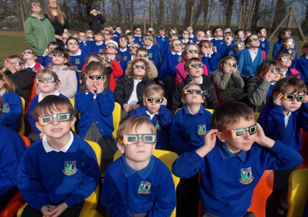 Children at the Bythams Primary School view the solar eclipse on March 20, 2015. EMN-150323-151348001