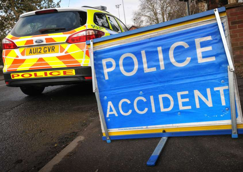 Police on the scene of an RTC - accident sign.