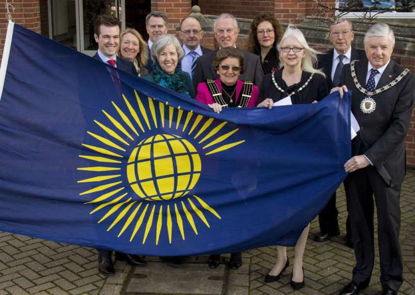 The Commonwealth flag is raised in Grantham.