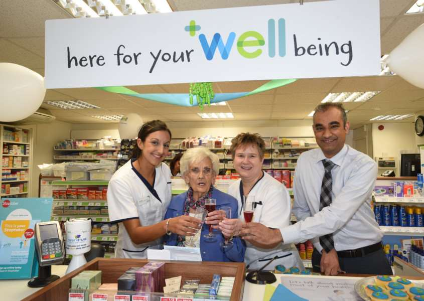 Betty Vellam (86) opening the Well Being pharmacy at Stamford . She is pictured with the staff - Emma Rodgers, Eileen Abbott and Shaz Sultan, manager. EMN-150828-104144009