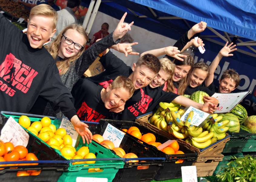 Rock You Theatre School members amongst the market stalls at Bourne Corn Exchange. Photo by Tim Wilson.