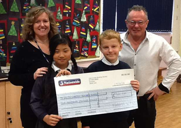 Andy Fardell presents a cheque for �500 to Edith Weston Academy head of school Jo Appleton EMN-161212-110359001