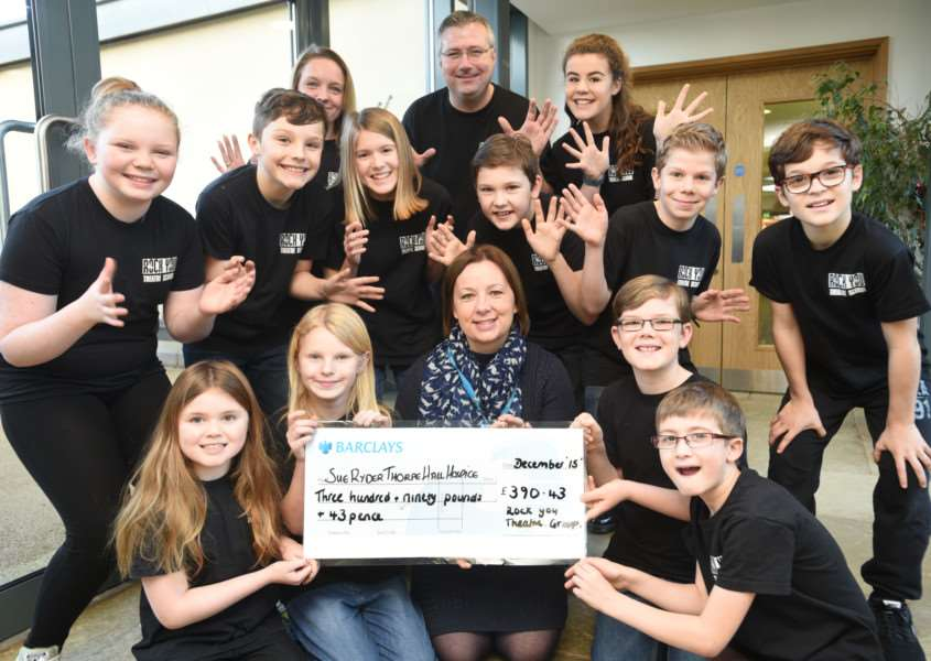 Rock You Theatre School from Bourne cheque presentation to Kirsty Clipston at Sue Ryder Care at Thorpe Hall EMN-151229-145940009