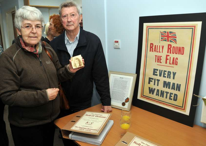 William and Wyn Jolley with a picture of their relative Patrick Harrison who died during The Battle of the Somme in 1914. Photo by Tim Wilson.