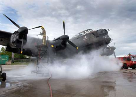 Fire crews tackel the engine fire which has put the BBMF's Laancaster Bomber out of action. Photo: RAF Crown Copyright