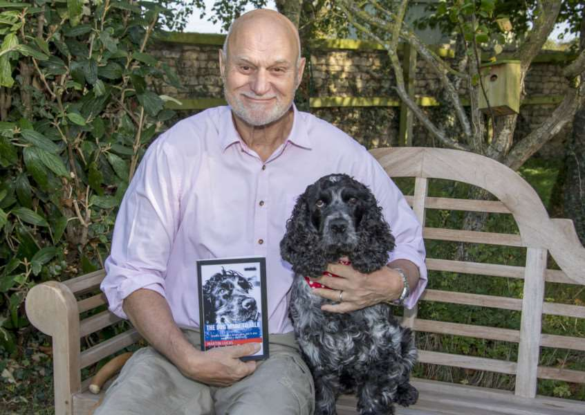 Writer Martin Lucas with Daisy and his new book