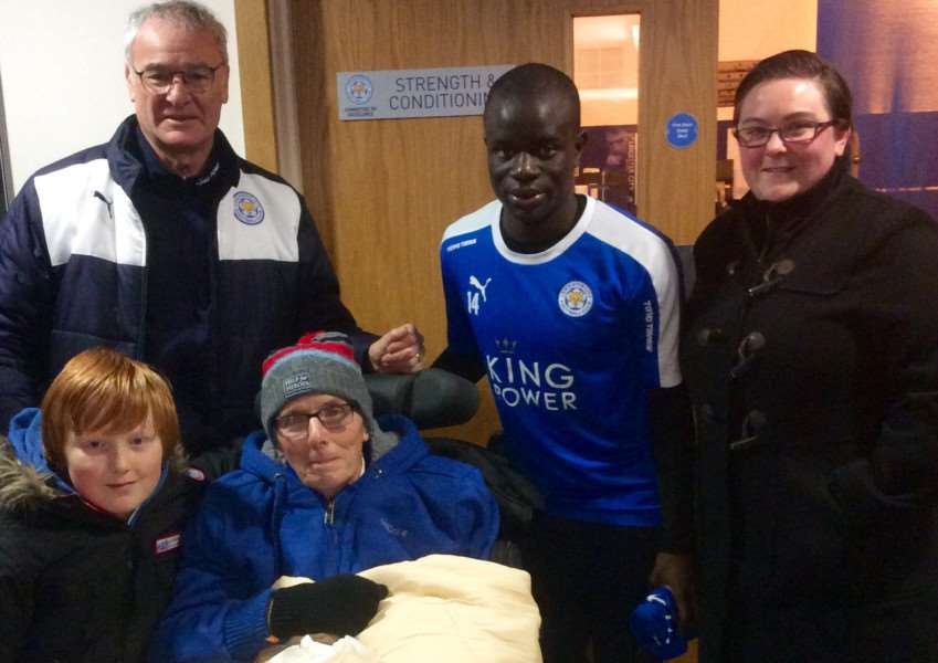 Rutland man Jim Chapman, who suffers from Motor Neurone Disease, visits his beloved Leicester City FC thanks to the Honeyrose Foundation.'Jim with manager Claudio Ranieri, midfielder N'Golo Kante, Becky Chapman and Hayden Meacham. EMN-160127-093032001