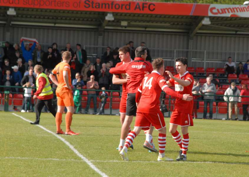 Stamford AFC celebrate beating Witton Albion on the final day of the season to avoid relegation. Photo: John Evely EMN-150425-180629001