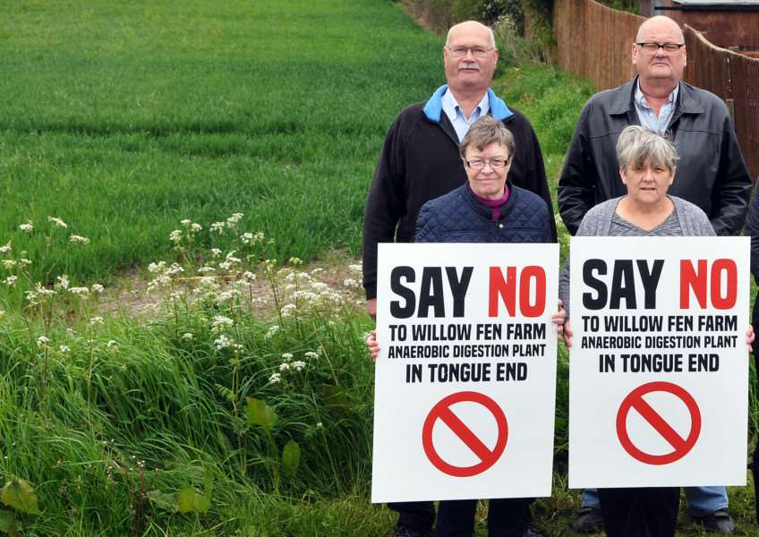 PLANT COMPROMISE: People from Tongue End protest against a proposed anaerobic digester plant on land off Counter Drain Drove in the village. Pictured are (back) Nick Garner, Bill Marshall, (front) Jill Nutt, Helen Eve and Jen Bates, with her dogs Meg and Galcha. Photo by Tim Wilson.
