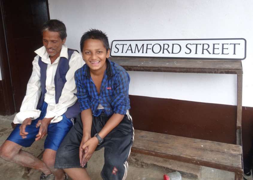 Krishna and son Kamal, 13, with the Stamford Street sign