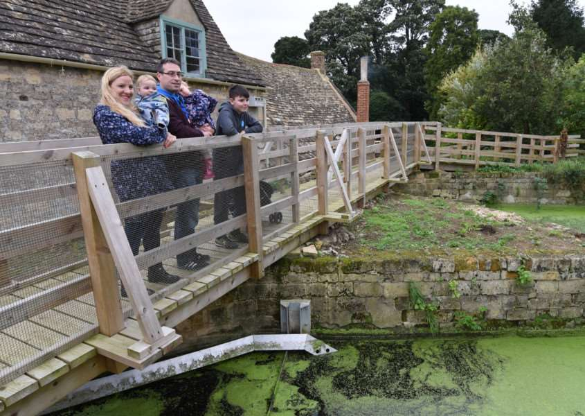 Visitors looking over the mill's water channel