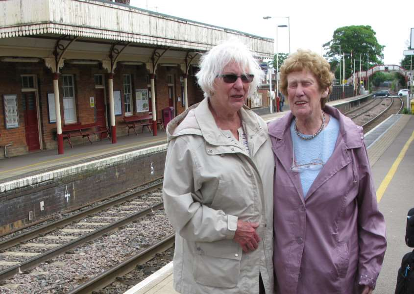 Penpals Gloria Allen (dark glasses) and Shirley Sloan meet for the first time at Oakham Station after 66 years. EMN-160523-143121001