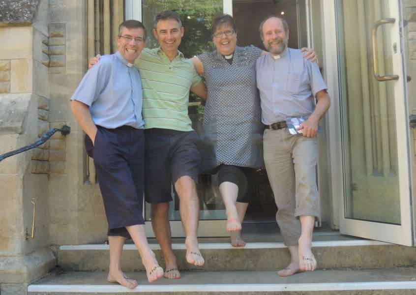 Stamford clergy walk barefoot to support the Leprosy Mission. Rev Andy Fyall, Rev Martyn Taylor, Rev Nikki Bates and Rev Don McGarrigle. EMN-150307-141249001