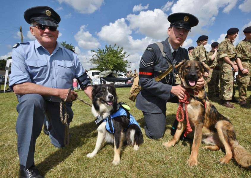 Armed Forces Day event at Market Deeping. Dog handlers Ray Anderson (with Jip) and Will Carr (with Hector) EMN-150628-202358009