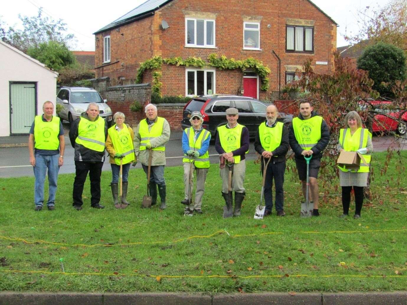 Rotarians from the Rotary Clubs of Bourne and Bourne St Peter join forces to plant crocus corms and daffodils on Morton Village Green