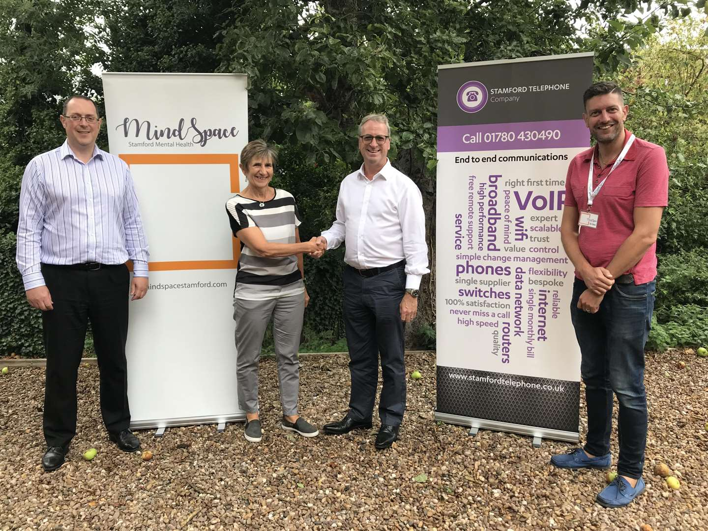 Chris Smith, Helen Howe, Mike Adams and Dan Petrie celebrate a collaboration between MindSpace Stamford and Stamford Telephone Company