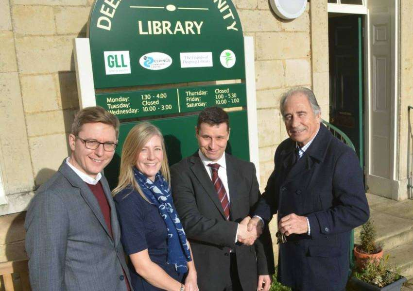 From left, Paul De'ath, Claire Carlson and Nick Carlson from Secret Source Marketing receive the keys to the new office from David Shelton, of Deepings Community Trust and the Friends of Deeping Library
