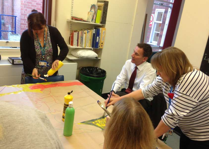 Health Secretary Jeremy Hunt joining in art activities during his visit to Ash Villa near Sleaford. Photo: LPFT EMN-161111-154333001