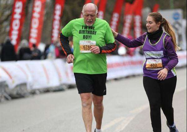 HELPING HAND: Student nurse Georgia Mae Bailey helps Trevor Stilgrove to finish the Cambridge Half-Marathon on his 66th birthday. Photo supplied.