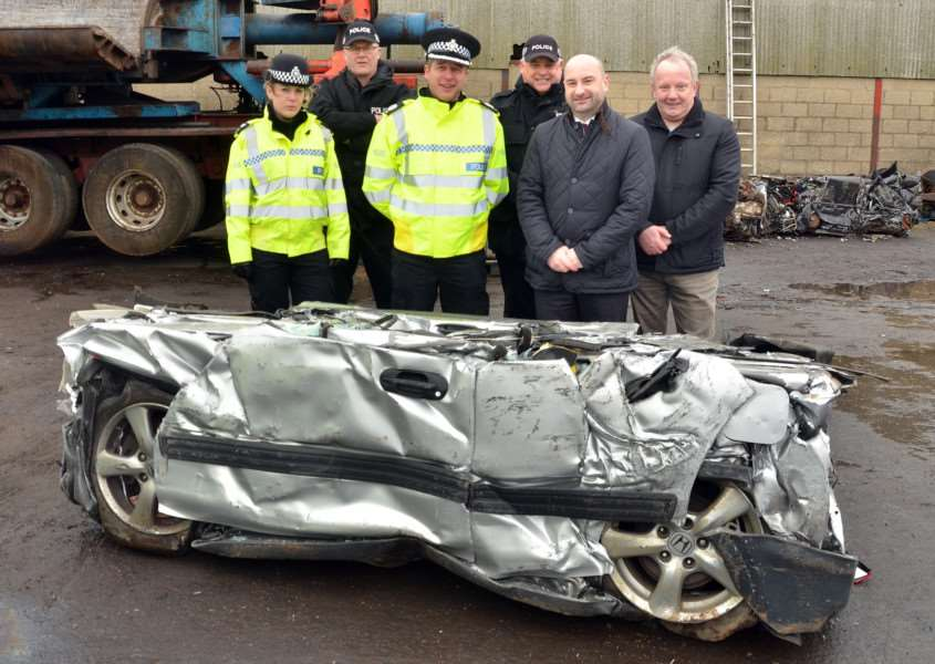 Sergeant Leanne Carr, PC Martin Green, Assistant Chief Constable Paul Gibson, PC Nick Willey, Crime Commissioner Marc Jones and Deputy Commissioner Stuart Tweedale with the crushed vehicle