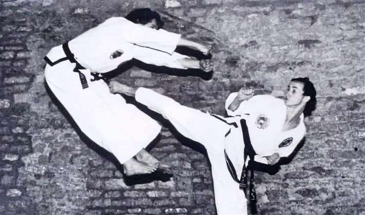 Dave Mears, right, in a taekwondo fight with Malcolm Scholes