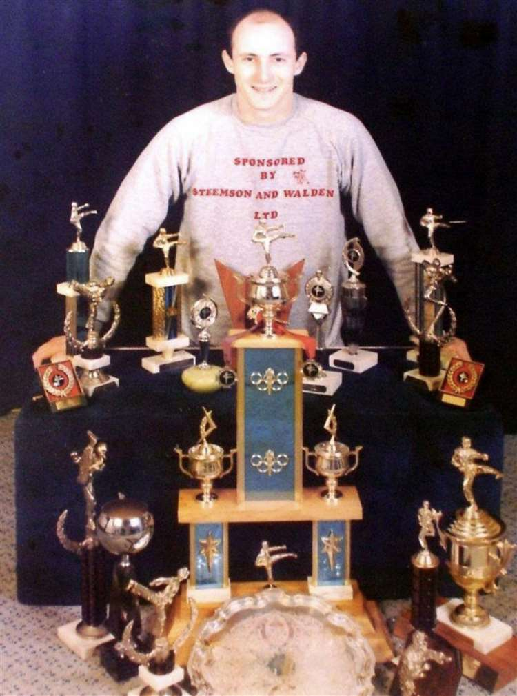 Dave Mears with his taekwondo trophies