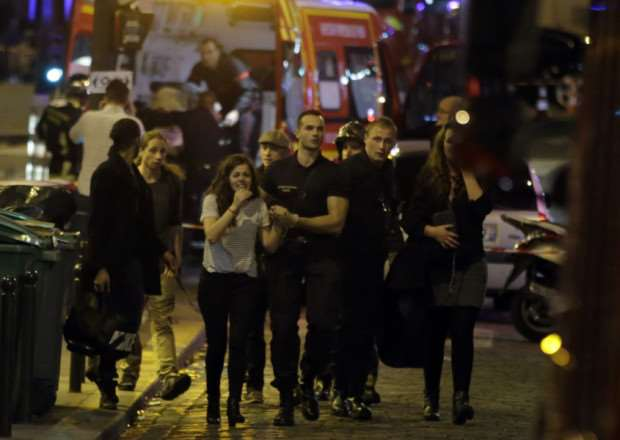 Rescuers evacuate people following an attack in the 10th arrondissement of the French capital. Picture: AFP/Getty Images