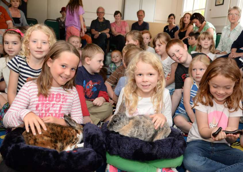 Youngsters meet animals at Rutland County Museum. Bryony Stuckey, Annabelle Fletcher and Sydney Wilkinson. Photo: Alan Walters MSMP-10-08-15aw001 EMN-150821-154814001