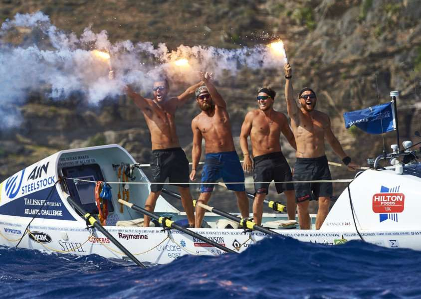 Team Ocean Reunion, comprising former Uppingham School pupils Angus Collins, 26, Joe Barnett, 25, Jack Mayhew, 26, and Gus Barton, 25, arrive at English Harbour in Antigua after beating 25 teams from across the world to win the world's toughest row, the Talisker Whisky Atlantic Challenge. Photos: Ben Duffy/PA Wire EMN-160127-101333001