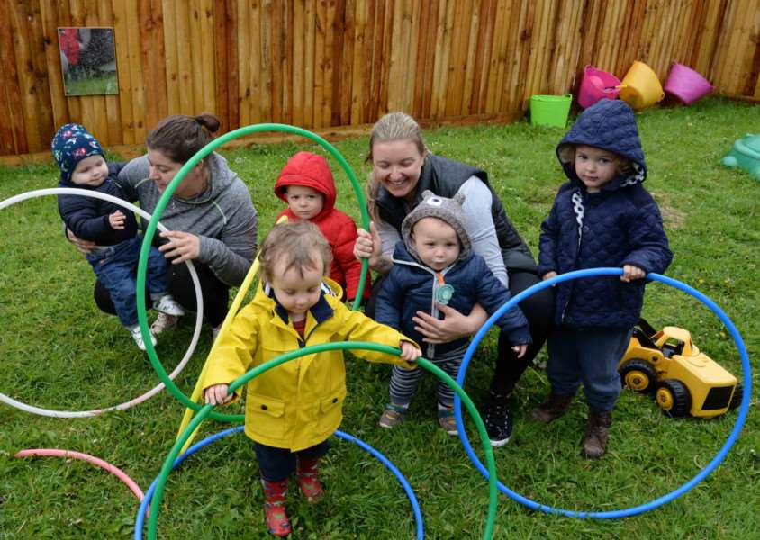 The garden at Oakham Day Nursery is getting a ?12,000 revamp. Co-owners Lucy Charlton and Charlotte Malony with Yves and Orla Phillips, George Kelly, Findlay Knott, and Sebastian Nowakowski. Photo: Alan Walters MSMP-18-05-15-aw001 EMN-150518-140919001