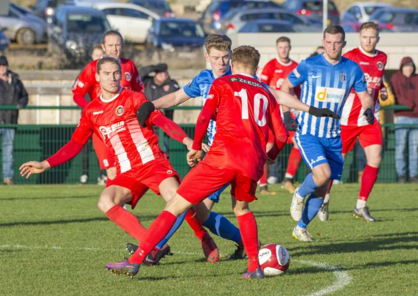Goalscorers Rob Morgan and Liam Adams (number 10) battle for possession against Corby on Boxing Day,