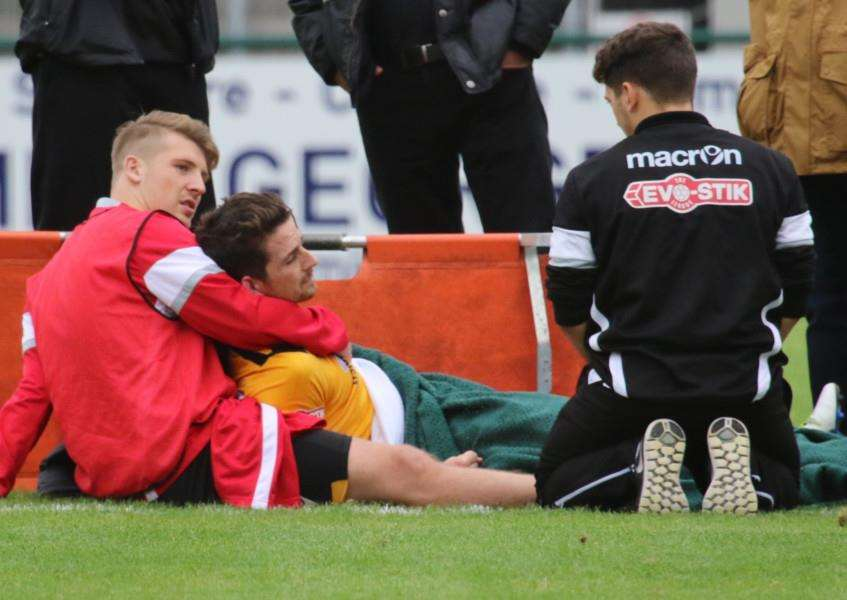 Basford United captain Jake Sheridan is treated on the pitch at the Zeeco Stadium on Saturday after breaking his tibia and fibula bones in his lower leg in a tackle against Stamford AFC. Photo: Geoff Atton EMN-161110-141031001