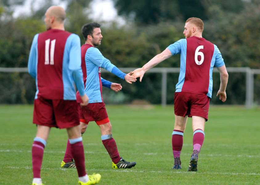 Jonny Clay (6) is congratulated by vice-captain Dan Flack.