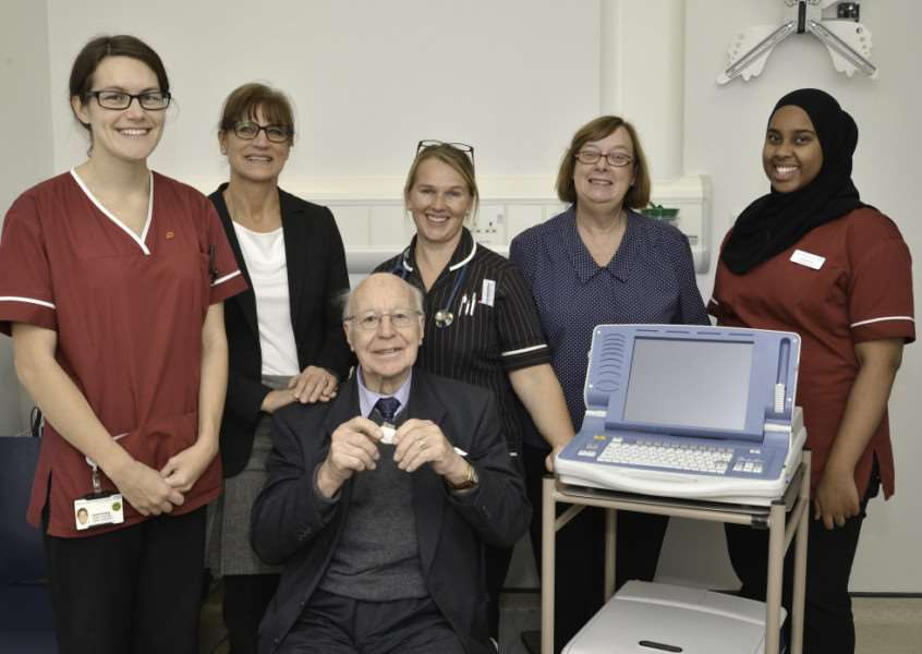 Mr Steel holds a pacemaker with, from left, Cardiac Physiologist Laura Conway, Shirley Steel, Mr Steel's daughter, Catherine Laventure, Arrhythmia Nurse Specialist, Sue King, Lead Administrator, and Farhiya Aden, Cardiac Physiologist