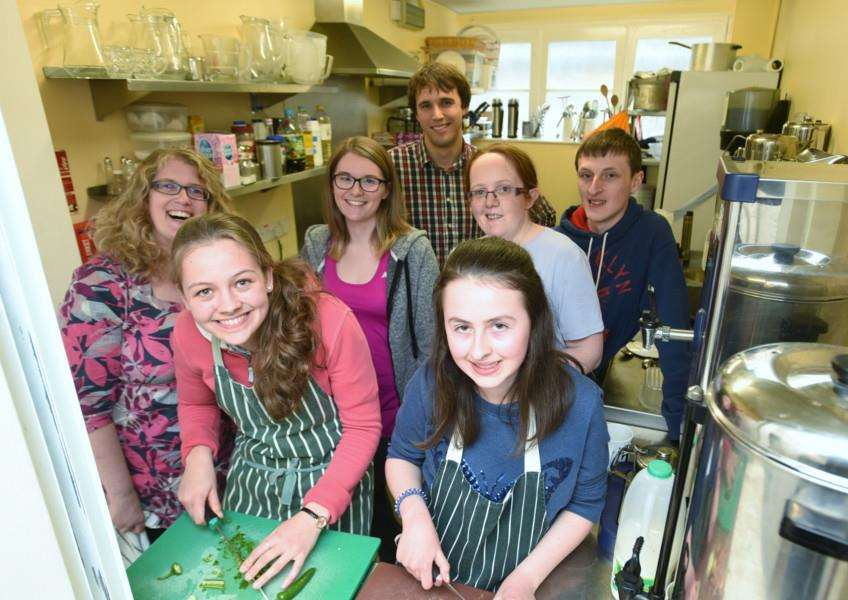 Lizzie Winfrey and Emily Caseley with other St George's Youth Ministry volunteers working at the Third's Cafe in Stamford EMN-160504-182558009