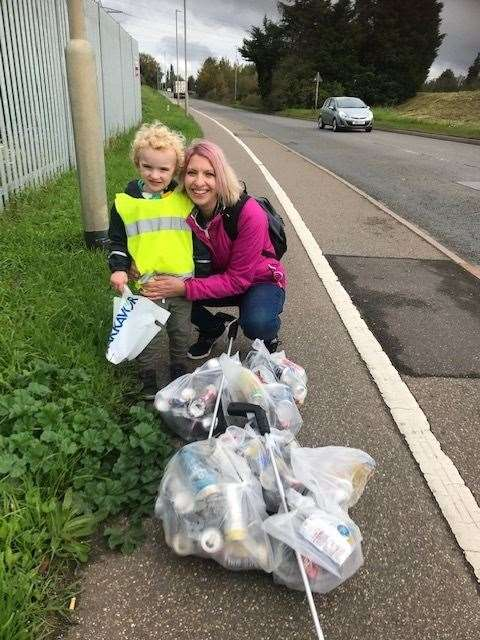 Calvin Pratt, a young litter picker, with his mum Aimee Stocker