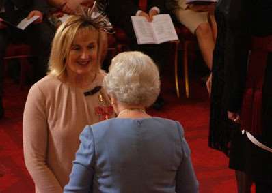Cherry Edwards receives her OBE for services to education from the Queen in October 2014.