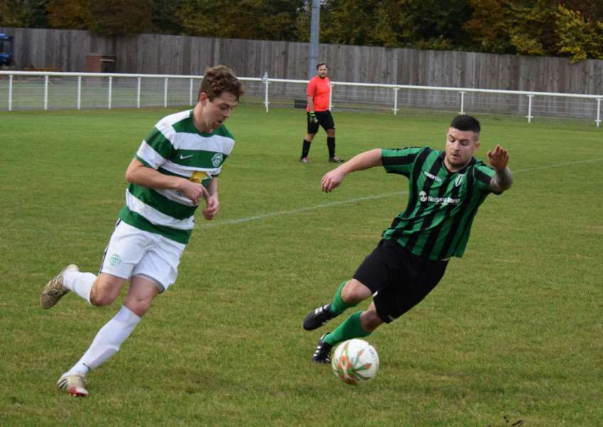 Action from Lutterworth Athletic against Blackstones. Photo: Martin Davies EMN-160211-164317001